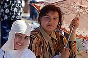 Tashkent, Uzbekistan, 12/05/2004..Women shelter from the sun at Chorsu [Chor Su] market, in central Tashkent.