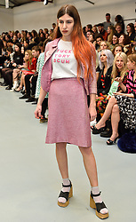 """© Licensed to London News Pictures. 23/02/2016.  LUISA LE VOGUER COUYET wears a t-shirt with the words """"FUCK TORY SCUM""""  at the the ASHLEY WILLIAMS show at the London Fashion Week Autumn/Winter 2016 show. Models, buyers, celebrities and the stylish descend upon London Fashion Week for the Autumn/Winters 2016 clothes collection shows. London, UK. Photo credit: Ray Tang/LNP"""