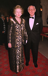 BARONESS THATCHER and her husband SIR DENIS THATCHER at a dinner in Berkshire on 19th November 1998.MME 23