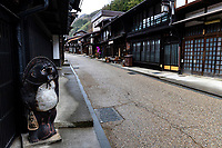 """Nakasendo at Narai Juku - The Gokaido highways were established by the Tokugawa shogunate as official routes for daimyo feudal lords and their retainers to travel from Kyoto to the capital Edo - now Tokyo. This system of paths and roads facilitated information, troops and dispatches from the government.  The passage of people and goods along these roads were checked at various barrier stations along the routes.  The Tokaido Road along the Pacific Coast, was the busiest route as it was the most direct and was mostly flat.  However, due to the number of river crossings involved along the Tokaido, it was considered dangerous, and many lords sent their wives and children on the longer, but safer inland highway, the Nakasendo. The Nakasendo or the """"highway through the eastern mountains""""  stretched 534 km fromKyoto to Tokyo over mountainous terrain.  Important post towns along the Nakasendo included Kusatsu, Maibara, Ochiai,  Miyanokoshi, Yabuhara, Shiojiri, Karuizawa, Maebashi and Kawaguchi. These post-towns provided accommodation and lodging for travelers and officials on the old highway. The Nakasendo trails are well marked and attract a growing number of hikers who wish to seek out rural and an older Japan."""
