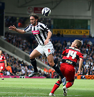 Photo: Mark Stephenson.<br /> West Bromwich Albion v Queens Park Rangers. Coca Cola Championship. 30/09/2007.West Brom's Jonathan Greening gets the better of Qpr's Martin Rowlands