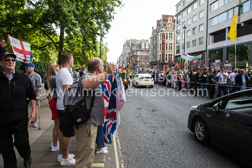London, UK. 10th June, 2018. Members of far-right groups and pro-Israel activists taunt hundreds of people taking part in the pro-Palestinian Al Quds Day march through central London organised by the Islamic Human Rights Commission. An international event, it began in Iran in 1979. Quds is the Arabic name for Jerusalem.