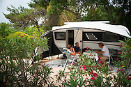 Lagos, Algarve, Portugal, June 2014. Camping Turiscampo near Lagos. A spectacular coastline of steep sandstone cliffs borders hidden sandy beaches on the south western tip of Europe, where the Mediterranean becomes the Atlantic Ocean.  Photo by Frits Meyst / MeystPhoto.com