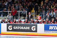 KELOWNA, CANADA - NOVEMBER 9: Kelly McCrimmon, Dave Lowry and Don Hay, coaching staff of Team WHL stand on the bench against the Team Russia on November 9, 2015 during game 1 of the Canada Russia Super Series at Prospera Place in Kelowna, British Columbia, Canada.  (Photo by Marissa Baecker/Western Hockey League)  *** Local Caption *** Kelly McCrimmon; Dave Lowry; Don Hay;
