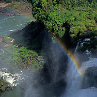 South America, Argentina, Brazil, Iguacu. Rainbow at Iguacu Falls.