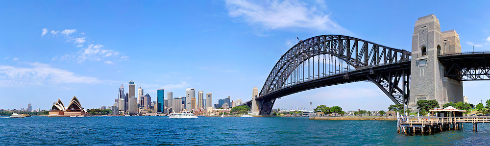 Sydney Harbour with city skyline and Sydney Harbour Bridge.
