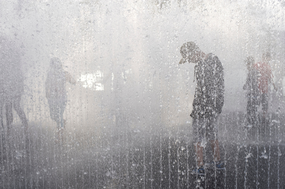 Teenagers frolic in a fountain outside the BFI Southbank in London on May 2, 2009.