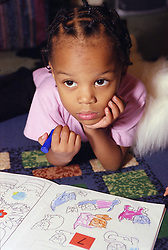 Portrait of young girl with colouring book,