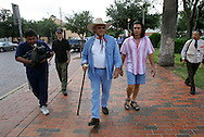 Jay Johnson Castro leaves Laredo's central plaza to start his journey on Tuesday, October 10, 2006.  Castro said he was walking over 200 miles from Laredo to Brownsville to protest the proposed border wall along the Rio Grande.