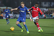 AFC Wimbledon midfielder Mitchell (Mitch) Pinnock (11) battles for possession with Barnsley attacker Mamadou Thiam (26)during the EFL Sky Bet League 1 match between AFC Wimbledon and Barnsley at the Cherry Red Records Stadium, Kingston, England on 19 January 2019.