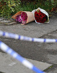 ©London News pictures...16/11/2010. Flowers left at the scene. A 44-year-old man has been arrested on suspicion of murder today (Tues) after a woman's body was found at a property in Bracknell in Berkshire. Officers visited the home in Inchwood in Birch Hill on Monday afternoon after a phone call from the victim's family, raising concern for her welfare. Stephen Simpson/London News Pictures.
