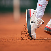 PARIS, FRANCE June 3. Clay falls from the soles of Roger Federer of Switzerland's tennis shoes during his match against Marin Cilic of Croatia on Court Philippe-Chatrier during the second round of the singles competition at the 2021 French Open Tennis Tournament at Roland Garros on June 3rd 2021 in Paris, France. (Photo by Tim Clayton/Corbis via Getty Images)
