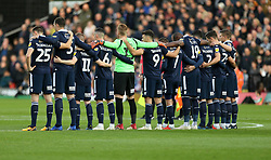 Millwall players during a 2 minutes silence