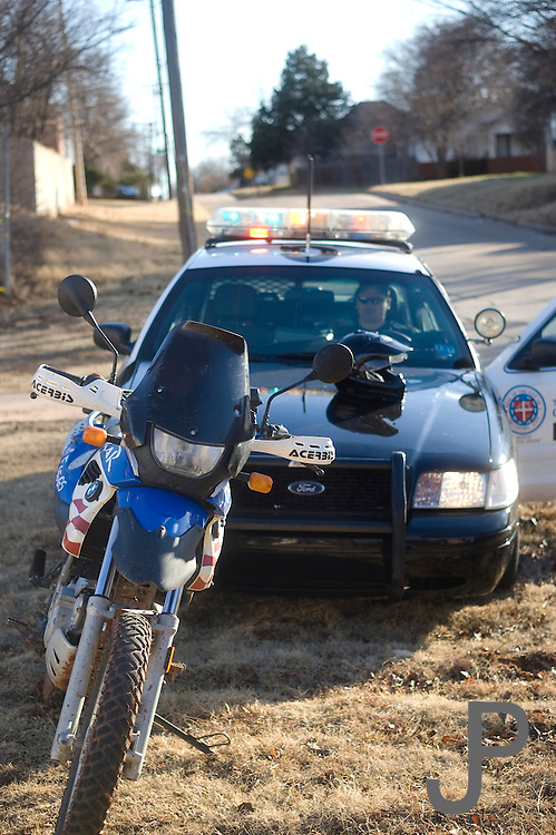 Motorcycle being pulled over by police officer