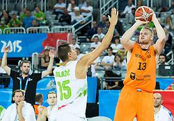 08-09-2015 CRO: FIBA Europe Eurobasket 2015 Slovenie - Nederland, Zagreb<br /> De Nederlandse basketballers hebben de kans om doorgang naar de knockoutfase op het EK basketbal te bereiken laten liggen. In een spannende wedstrijd werd nipt verloren van Slovenië: 81-74 / Jure Balazic of Slovenia vs Rowland Schaftenaar of Netherlands. Photo by Vid Ponikvar / RHF