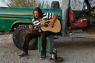 Donald Harter, 55, plays a love song to his wife who passed away recently. He was deployed in Somalia as a special forces weapons expert, and seemingly suffers from PTSD. His best friend in Slab City, Jimmy Ray Silva, introduced us, but warned of his volatile mood swings, which I saw first hand.