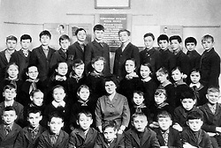 Before rising to power as one of the most infamous leaders in the world, Putin was a playful, hipster-dressing man in love. circa 1965 - St. Petersburg, Russia - A class photo with VLADIMIR PUTIN, 13, (first row, third from right), dated 1964-65. (Credit Image: © Russian Archives via ZUMA Wire)