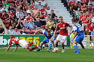 Matt Ritchie of Swindon Town (10) looks for a way past Martin Rowlands (22). NPower league one, Swindon Town v Leyton Orient at the County Ground in Swindon on Saturday 8th Sept 2012.  pic by  Andrew Orchard, Andrew Orchard sports photography,