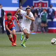 Carli Lloyd, (right), U.S. Women's National Team, dribbles past Hah-nul Kwon, Korean Republic, during the U.S. Women's National Team Vs Korean Republic, International Soccer Friendly in preparation for the FIFA Women's World Cup Canada 2015. Red Bull Arena, Harrison, New Jersey. USA. 30th May 2015. Photo Tim Clayton