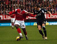 Photo: Tony Oudot.<br />Charlton Athletic v West Ham United. The Barclays Premiership. 24/02/2007.<br />Jimmy Floyd Hasselbaink of Charlton with Matthew Etherington of West Ham