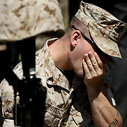 CAMP LEJEUNE, NC  - APRIL 30:  Corp Sean Potter mourns at the memorial for Corp. Jacob H Turbett at the 2nd Marine Expeditionary Brigade service honoring the unit's Marines and sailors killed during their recent deployment to Afghanistan on Friday, April 30, 2010 in Camp Lejeune. The 2nd MEB deployed to Afghanistan's Helmand province in April 2009 in support of NATO's International Security Assistance Force.   The unit spent nearly 12 months partnered with Afghan security and other NATO forces prosecuting a highly successful campaign against Taliban and other anti-government forces in southern Afghanistan.  The MEB returned to the United States earlier this month. (Photo by Logan Mock-Bunting/ZUMA Press)