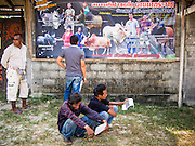 08 FEBRUARY 2014 - PHAWONG, SONGKHLA, THAILAND: People wait to get into a bullfighting ring in a rural part of Songkhla province in southern Thailand. Bullfighting is a popular past time in southern Thailand. Hat Yai is the center of Thailand's bullfighting culture. In Thai bullfights, two bulls are placed in an arena and they fight, usually by head butting each other, until one runs away or time is called. Huge amounts of mony are wagered on Thai bullfights - sometimes as much as 2,000,000 Thai Baht ($65,000 US).   PHOTO BY JACK KURTZ