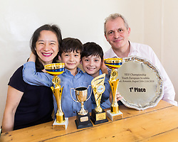 Parents Alvin, 56, a concert pianist and Hiroko, 51, a baroque violinist are strong supporters of Josh, 8, and Reubin, 11, shown here with some of their trophies.  Brothers Reuben and Josh Moisey are top level Scrabble Champions with 11 year-old Reuben crowned European Youth Scrabble Champion and 8 year-old Josh became World Under Eight Scrabble Champion in Dubai in 2018. London, August 15 2019.