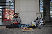 A young man who has been sleeping on the street for months, offers to play a game of chess to anyone on the street. José is not afraid of COVID19 disease. He thinks this is only the beginning of other pandemics to come. Barcelona, March 26th. Photo by Eva Parey.