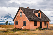 The Pink House preserved at John Moulton Homestead, at the corner of Mormon Row and Antelope Flats Road, in the valley of Jackson Hole, Grand Teton National Park, Wyoming, USA.