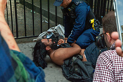 A man is detained by police as demonstrators gathered outside India House in London to show support for Kashmiris and to protest against occupation and oppression by India in Kashmir.<br /> <br /> Police worked to keep the protesters and counter protesters apart through use of barriers, mounted police and lines of police. <br /> <br /> Richard Hancox | EEm 15082019