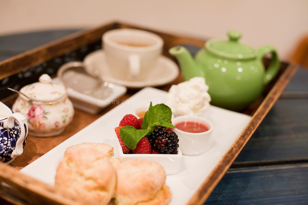 """5 November, 2008. New York, NY. Cream tea and a sweet dish are on a tray here at the Podunk, a self-styled """"American tearoom"""" in the East Village.The owner, Elspeth Treadwell, left a career in publishing to open Podunk six years ago, in 2002. <br /> <br /> ©2008 Gianni Cipriano for The New York Times<br /> cell. +1 646 465 2168 (USA)<br /> cell. +1 328 567 7923 (Italy)<br /> gianni@giannicipriano.com<br /> www.giannicipriano.com"""