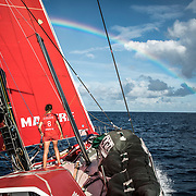 Leg 4, Melbourne to Hong Kong, day 12 on board MAPFRE Sophie Ciszek at the bow with a reinbow in the sky. Photo by Ugo Fonolla/Volvo Ocean Race. 12 January, 2018.