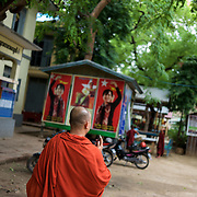 "May 14, 2013 - Mandalay, Myanmar: Ashin Wirathu, the buddhist monk leader of Burma's anti-Muslim movement 969 group, walks by posters of opposition leader Aung San Suu Kyi, in the grounds of Mosayein Monastery in central Mandalay. Wirathu, who was jailed in 2003 for inciting religious hatred, refers to himself as ""the Burmese Bin Laden"". CREDIT: Paulo Nunes dos Santos"