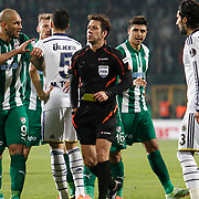 Referee's Rifat Aydinus (C) during the Turkish soccer super league match Bursaspor between Fenerbahce at the Ataturk Stadium in Bursa Turkey on Monday, 24 November 2014. Photo by Aykut AKICI/TURKPIX