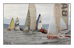 The 2004 Skiff Nationals at Largs held by the SSI.<br /> <br /> Base 1 helmed by Rob Dulso to lee of the fleet at the start.<br /> <br /> Marc Turner / PFM Pictures
