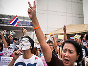 """02 JUNE 2013 - BANGKOK, THAILAND: Anti-government protesters march through Bangkok. The so called White Mask protesters are strong supporters of the Thai monarchy. About 300 people wearing the Guy Fawkes mask popularized by the movie """"V for Vendetta"""" and Anonymous, the hackers' group, marched through central Bangkok Sunday demanding the resignation of Prime Minister Yingluck Shinawatra. They claim that Yingluck is acting as a puppet for her brother, former Prime Minister Thaksin Shinawatra, who was deposed by a military coup in 2006 and now lives in exile in Dubai.     PHOTO BY JACK KURTZ"""