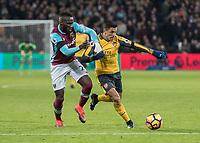 Football - 2016 / 2017 Premier League - West Ham United vs. Arsenal <br /> <br /> Alexis Sanchez of Arsenal holds of Arthur Masuaku of West Ham as he attack at The London Stadium.<br /> <br /> COLORSPORT/DANIEL BEARHAM