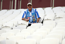 Huddersfield Town fans take their seats in the stands ahead of the game