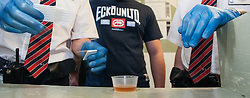 Prison officer carries out a urine test for drugs UK prison