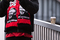 Football - Premier League 2012 / 2013 - Manchester United vs. Swansea<br /> A fan wears a Alex Ferguson, manager of Manchester United scarf at Old Trafford