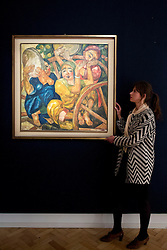 © Licensed to London News Pictures. 31/05/2013. London, UK. A Bonhams employee is seen with 'The Child Musicians' (est. GB£200,000-400,000) a 1926 painting by Alexander Nikolaevich Volkov at the press view for a sale of Russian art in London today (31/05/2013). The Russian sale, one of two held each year by Bonhams dedicated Russian Department  is set to take place on Wednesday the 5th of June.. Photo credit: Matt Cetti-Roberts/LNP