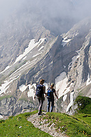 Two female hikers on trail of Mittenwalder Hoehenweg in German Alps, Mittelwald, Germany