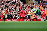 Sadio Mane of Liverpool (l) celebrates with his teammates after scoring his teams 3rd goal.  FCPremier League match, Liverpool v Hull City at the Anfield stadium in Liverpool, Merseyside on Saturday 24th September 2016.<br /> pic by Chris Stading, Andrew Orchard sports photography.