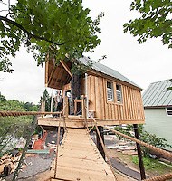 Bob Cosco gets a birds eye view from the deck of the tree house he has been building on Riverside Court in Laconia.    (Karen Bobotas/for the Laconia Daily Sun)