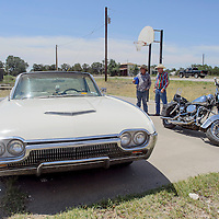 Judges, spectators and other entrants gather around Welton Moorhead's 1964 Thunderbird during the car show at the Homesteaders Reunion Saturday in Fence Lake.