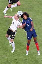 05-07-2011 VOETBAL: FIFA WOMENS WORLDCUP 2011 FRANCE - GERMANY: MONCHENGLADBACH<br /> Kopfball / Kopfballduell zwischen Alexnadra Popp (GER11 #11, Duisburg) (L) gegen Wendie Rennrad (Frankreich)<br /> ***NETHERLANDS ONLY***<br /> ©2011-FRH- NPH/Mueller