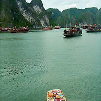Vietnamese women selling goods in a small boat at Ha Long