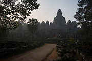 Dawn scene at Bayon, the central state-temple at the heart of Angkor Thom. Built in the late 12th century, Bayon is adorned with stunning bas-reliefs although is best known for it's amazing collection of towers, 37 in all, and the large majority of which are carved with four faces. Bayon was Jayavarman VII's  state temple and represents the pinnacle of his building campaign.