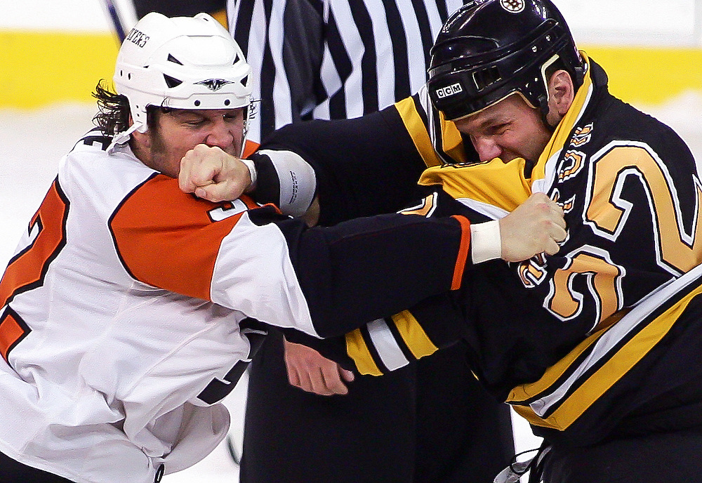 (102707 Boston, MA)  Boston Bruins Shawn Thornton throws a punch at Philadelphia Flyers Riley Cote during the first period of their game at TD Banknorth Garden.