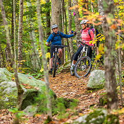 Mountain bikers ride in the Raymond Community Forest in Raymond, Maine. Fall.
